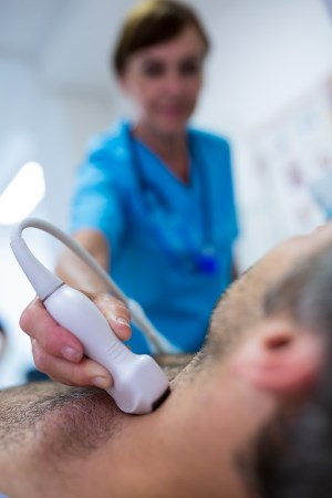 Provo Utah ultrasound tech testing man's neck